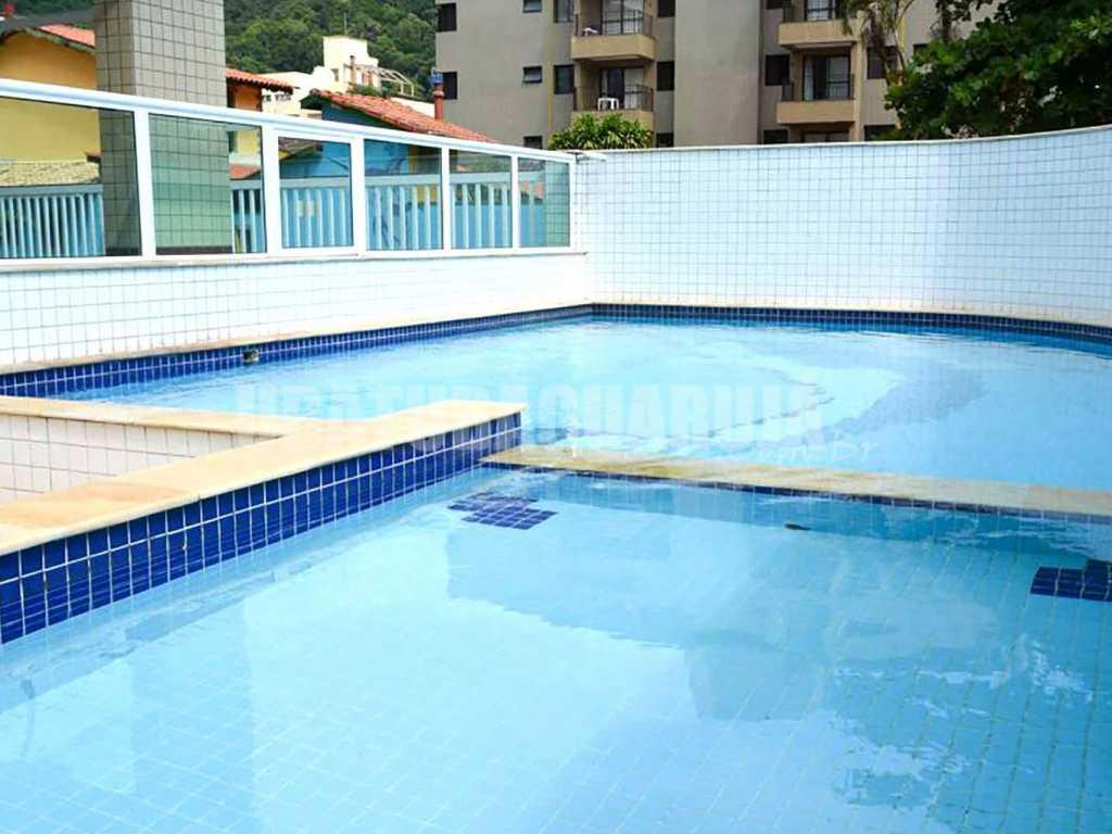 Apartamento 12 de 3 dormitórios para 8 pessoas a uma quadra da Praia Grande - Ubatuba